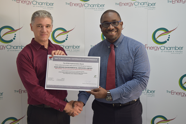 "EES Managing Director, Neil Harper is presented with the STOW-TT certificate by Trinidad & Tobago Energy Chamber CEO, Dr. Thackwray ""Dax"" Driver"