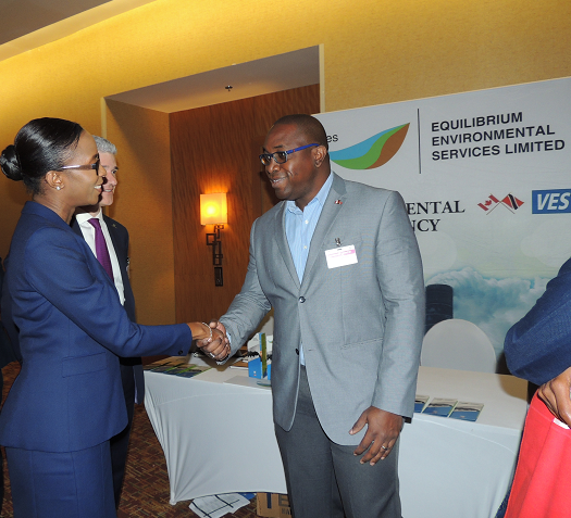"Energy Conference 2016, Day 3 – EES Managing Director, Neil Harper, is greeted by The Honourable Nicole Olivierre(MP), Minister of Energy.  Looking on his Trinidad & Tobago Energy Chamber CEO, Dr. Thackwray ""Dax"" Driver."