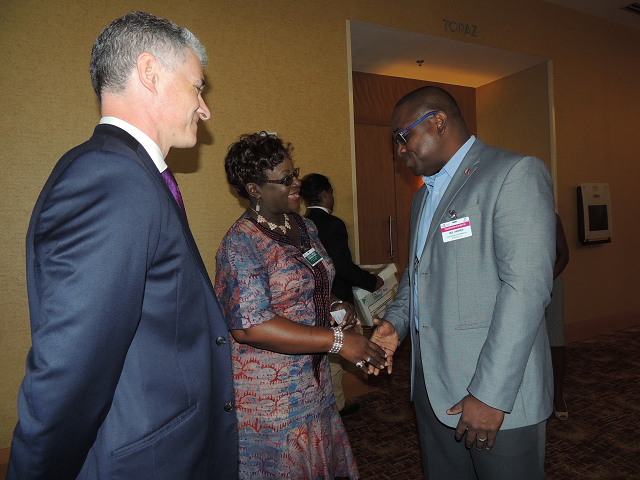 "Energy Conference 2016, Day 1 – EES Managing Director, Neil Harper, is warmly greeted by The Honourable Camille Robinson-Regis(MP), Minister of Planning & Development.  Looking on his Trinidad & Tobago Energy Chamber CEO, Dr. Thackwray ""Dax"" Driver."